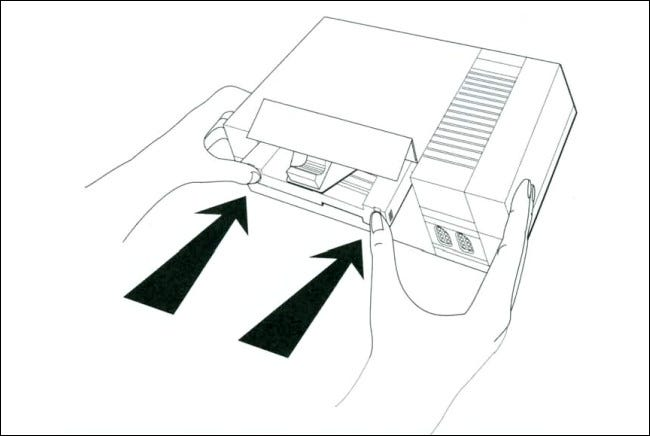 A line diagram of inserting the Game Genie into the NES from the Game Genie manual.