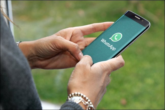 A person chatting with WhatsApp on a smartphone.