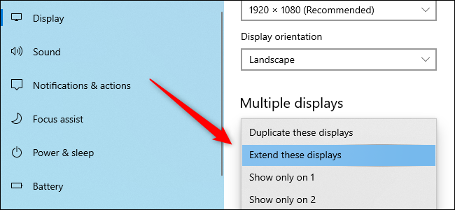 The Windows 10 Settings app shows the option to adjust multiple monitors.