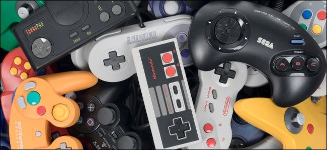 A pile of retro video game controllers.
