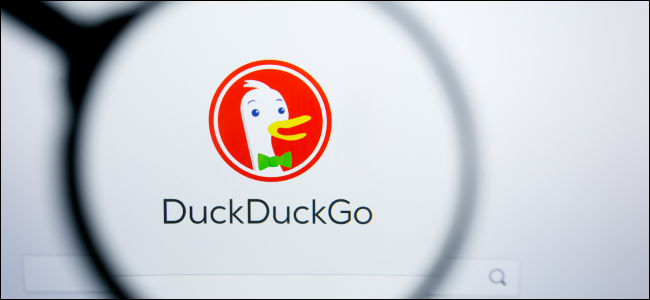 The DuckDuckGo logo under a magnifying glass.