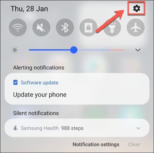Scroll down to view the notification shade, then tap the gear icon.