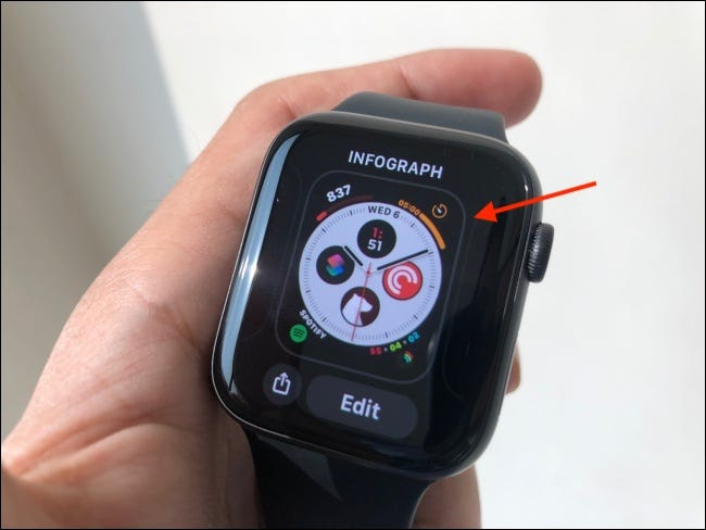 Tap and hold the watch face to pick it up