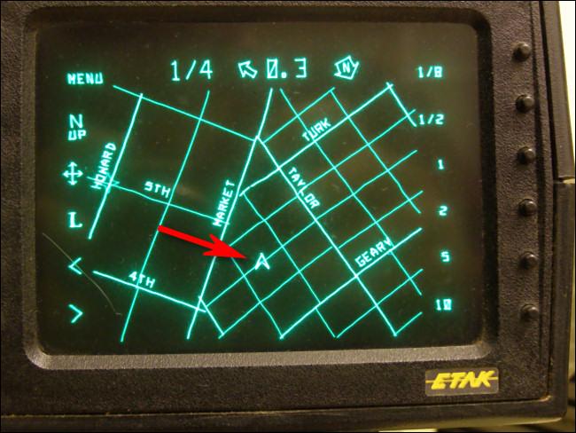 The original Etak arrowhead navigational cursor as seen on a 1985 Etak Navigator display.