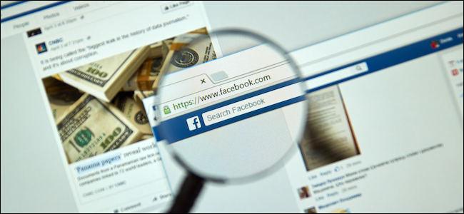 The Facebook website seen through a magnifying glass