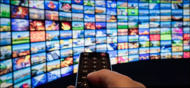 A TV remote pointing at a grid of thumbnails.