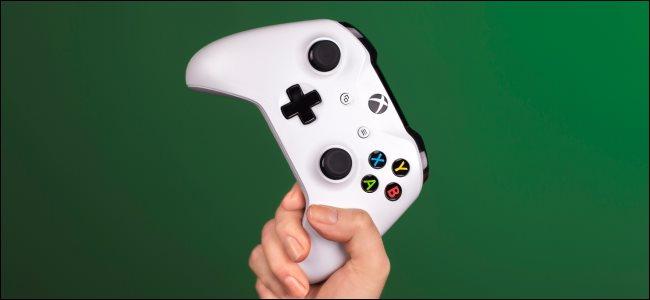 A hand holding an Xbox controller.