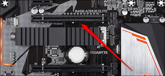 Close-up of a PCIe x16 slot with a red arrow pointing to it.
