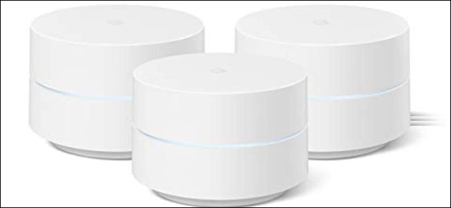 Three Google WiFi pucks all white, with light blue LED accent in the center.