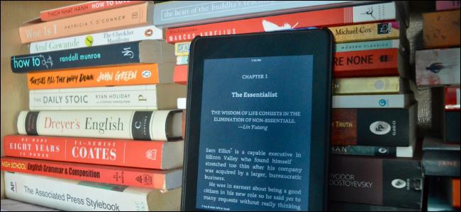 Kindle User Reading Book in Dark Mode