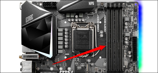 The RAM slots on a motherboard with the red arrow facing it.