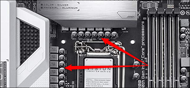 Close-up of a CPU socket with two red arrows pointing to the VRM.