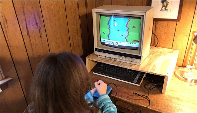 A child playing River Raid on an Atari 800XL computer.