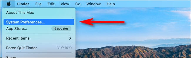 """Click the Apple logo in the corner of the screen and select """"System Preferences"""" from the menu."""