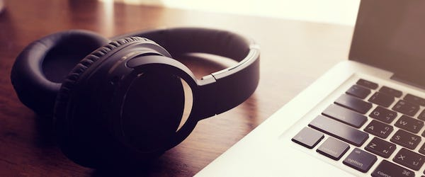 bluetooth-headphones-laying-next-to-a-ma