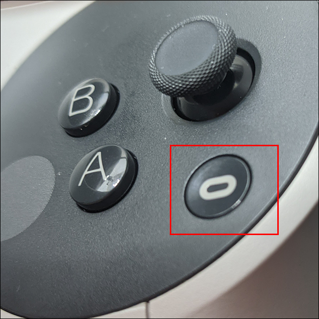 Press the Oculus button on the right controller and press either trigger.