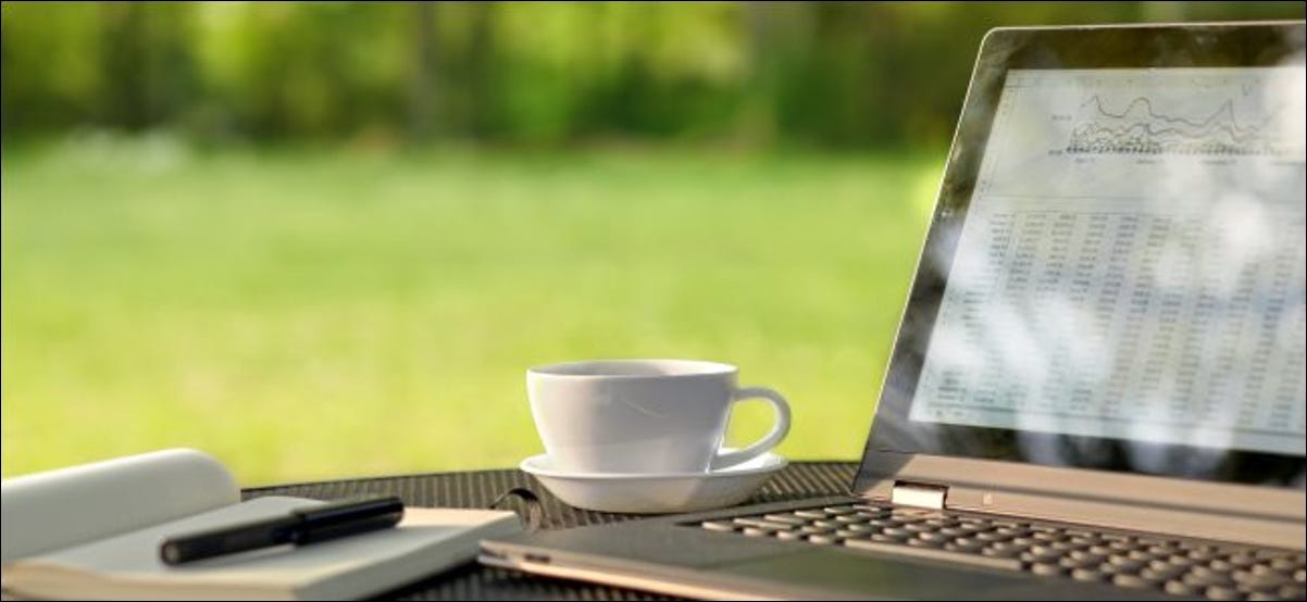 A laptop outdoors on a sunny day with glare on the screen.