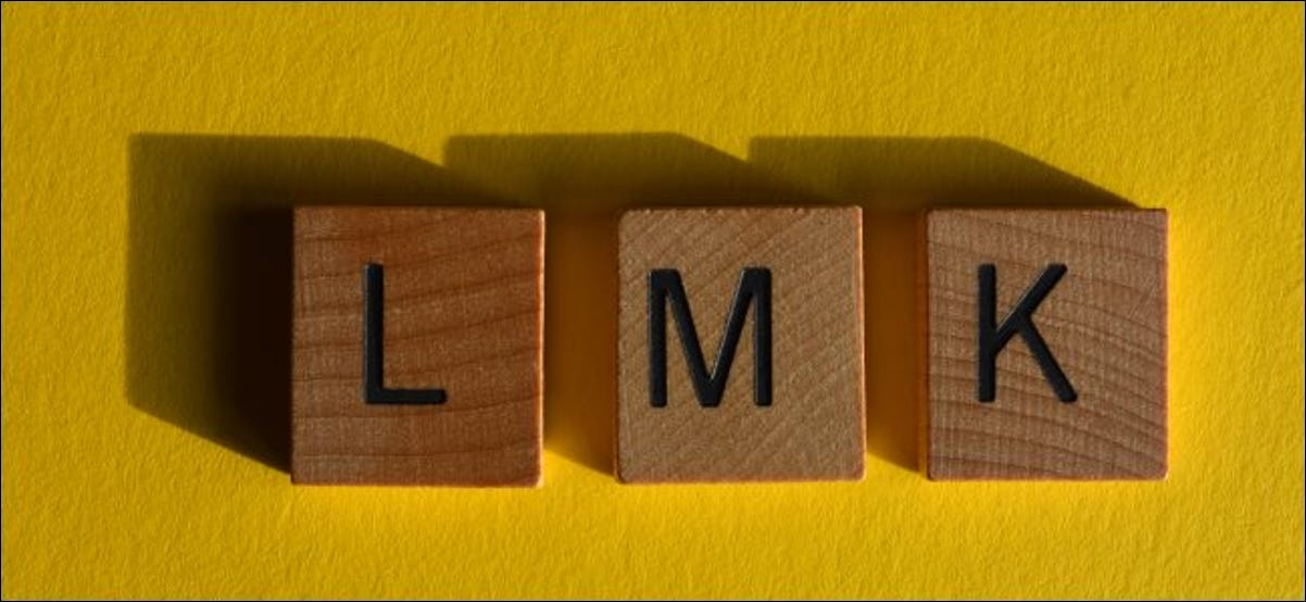 """The letters """"LMK"""" spelled out in blocks."""