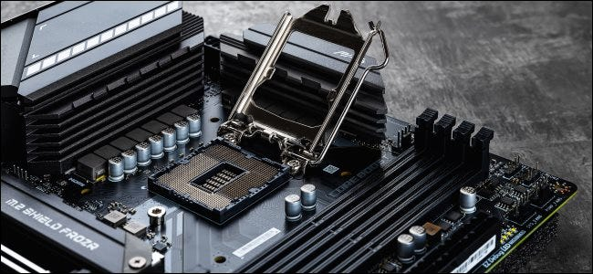 A bare Intel CPU socket with the retention bracket up.