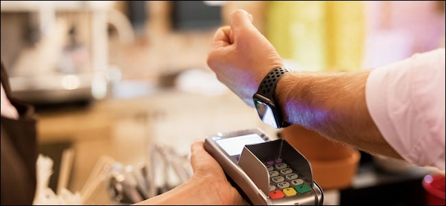 Person using an Apple Watch with Apple Pay