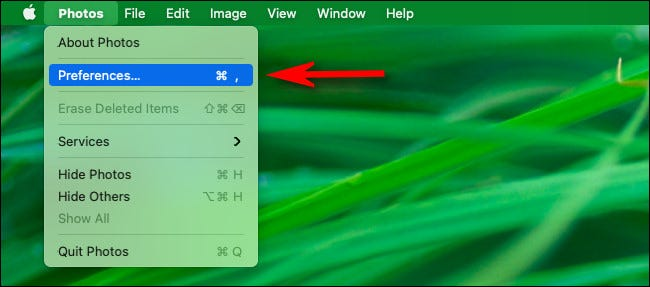 "In the menu bar, click ""Photos"" then select ""Preferences"" from the menu."