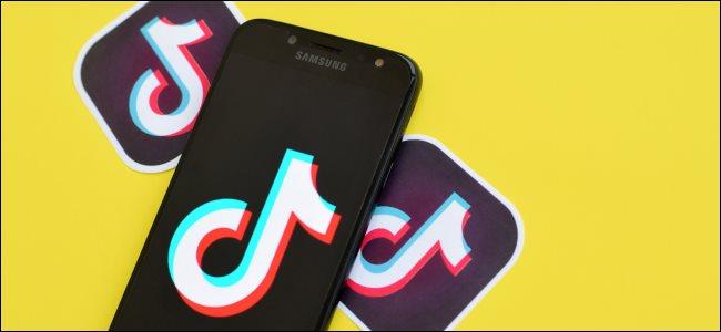 TikTok app logos on and around a smartphone.