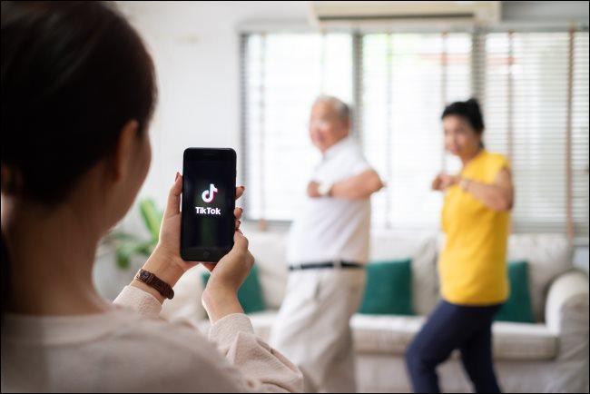 Filming people dancing with TikTok.