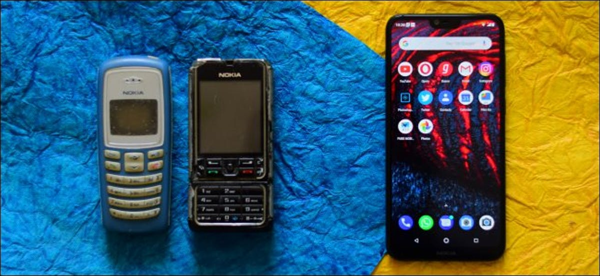 Feature phones next to a modern smartphone.