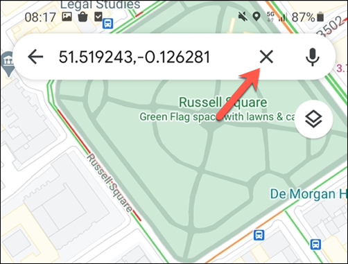 To remove a temporary pin in Google Maps, tap the cross icon on the search bar, or tap elsewhere on the map.