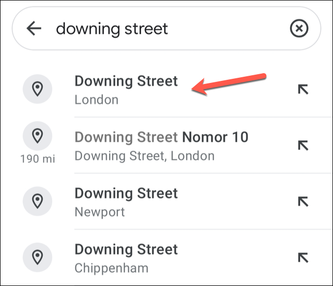 To drop a pin automatically in Google Maps on mobile devices, search for a location using the search bar, then tap on one of the search suggestions underneath.