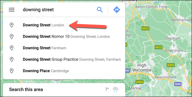 To drop a pin automatically, open Google Maps and use the search bar in the top left to find a location.