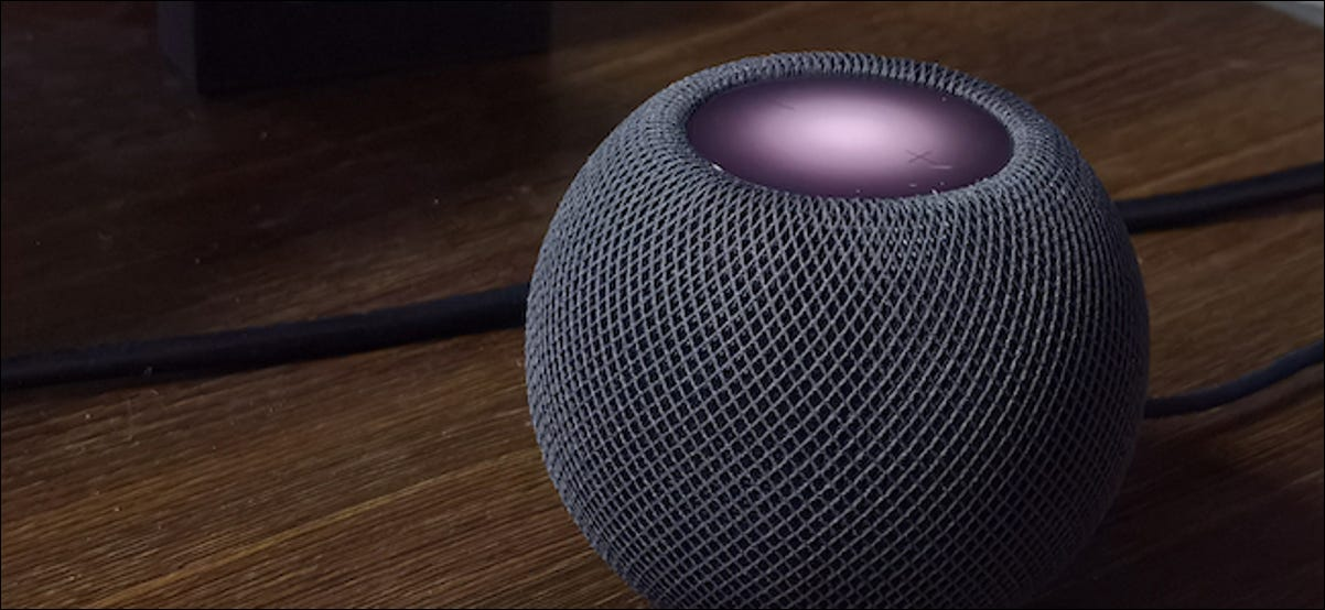 Apple HomePod Mini with visible touch controls visible