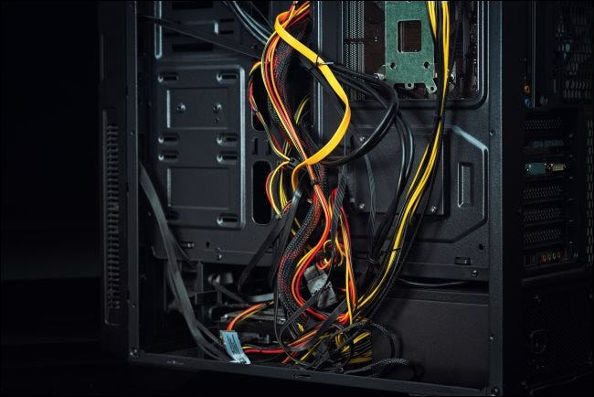Bad, messy cable management inside a PC case.