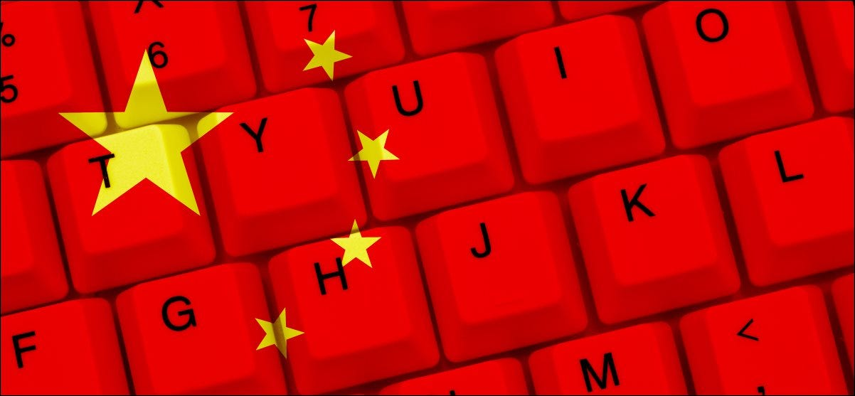 The Chinese flag superimposed over a computer keyboard.