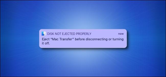 """Il messaggio di avviso """"Disco non espulso correttamente"""" di Apple Mac su sfondo blu."""