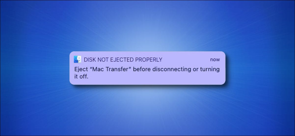 """The Apple Mac """"Disk Not Ejected Properly"""" warning message on a blue background."""