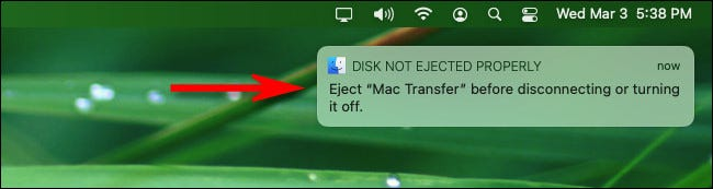 """The """"Disk Not Ejected Properly"""" warning message on macOS Big Sur."""