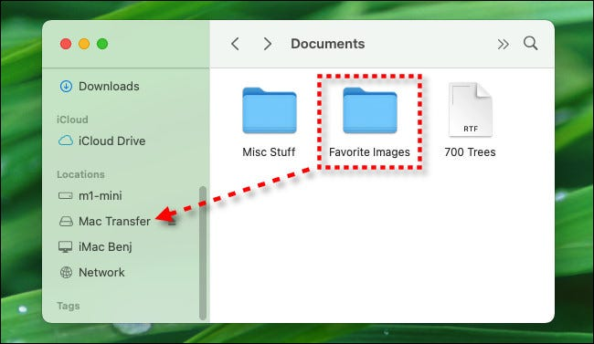 Drag files onto the USB flash drive's name in your Finder sidebar.