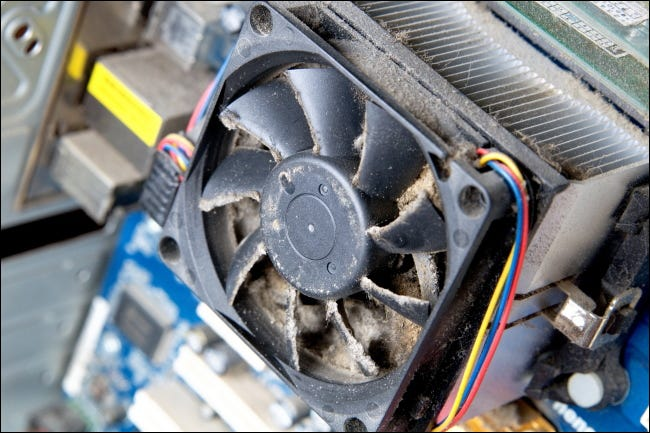 A dusty fan in the housing of a PC.