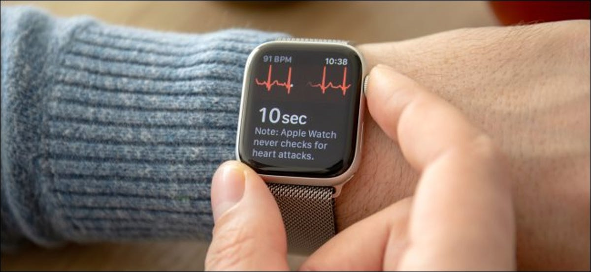 A person taking an ECG with the Apple Watch.