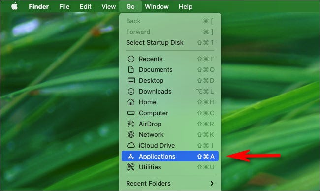 """In Finder, click the """"Go"""" menu and select """"Applications"""" from the list."""