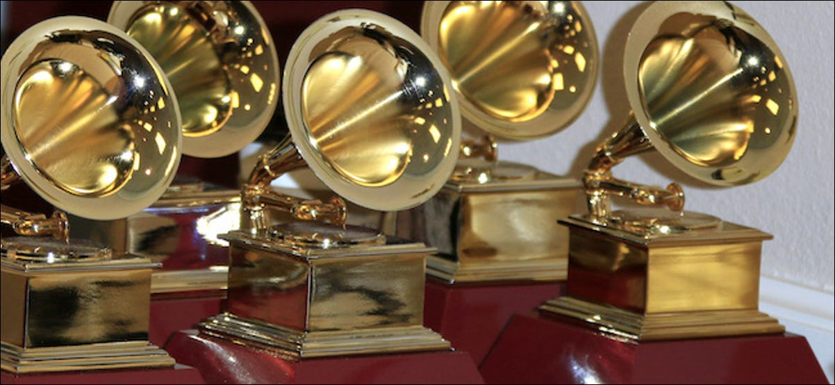 Grammy awards lined up on a table