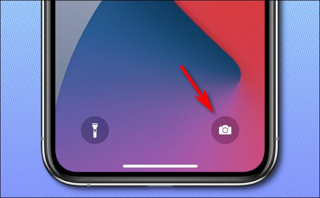On the iPhone lock screen, long press the camera icon to launch the Camera app.