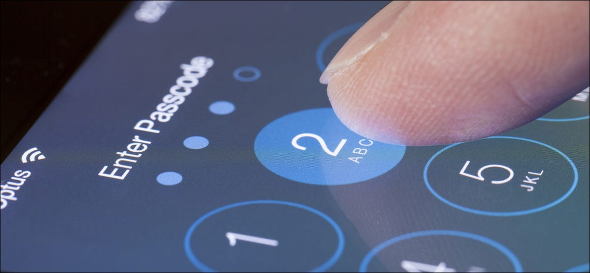 Person entering a passcode on the lock screen of their iPhone