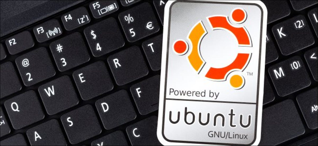 A Ubuntu sticker on a PC keyboard.;