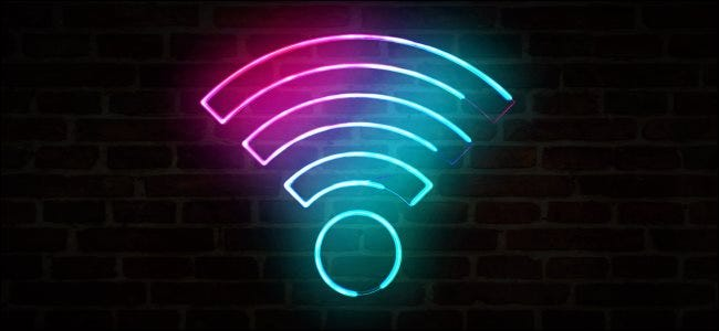 A neon Wi-Fi sign on a wall.