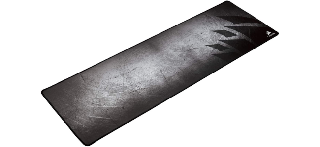 A black and grey elongated mouse mat with the Corsair logo.