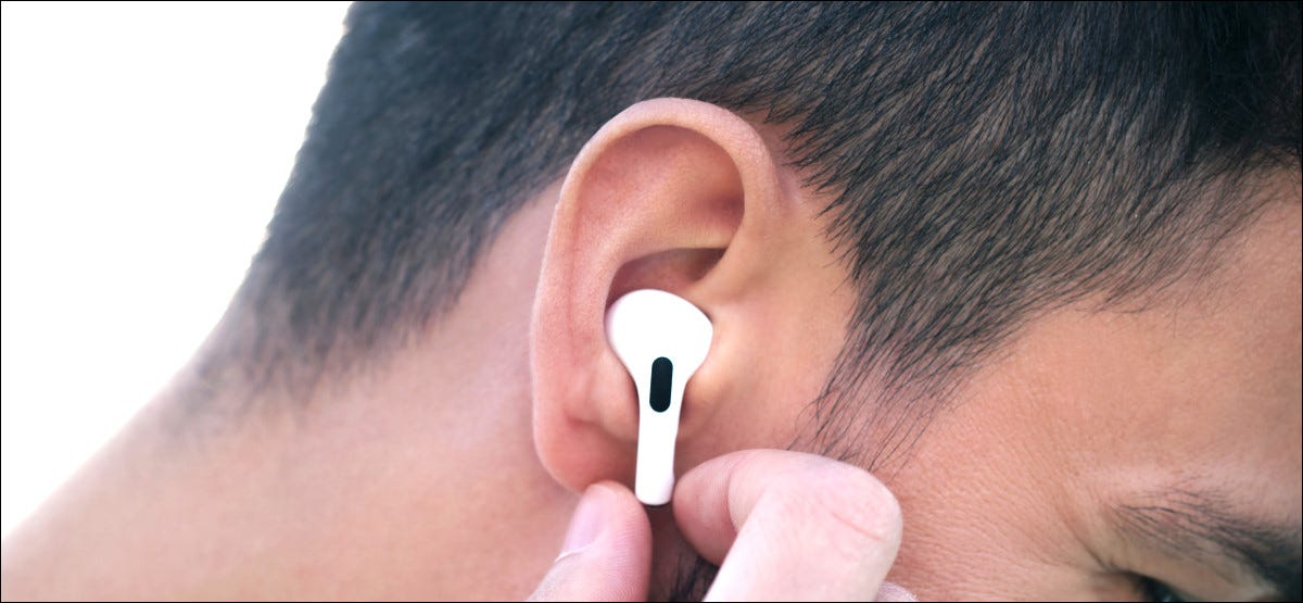 iPhone User Listening to New Incoming Messages Using AirPods Pro