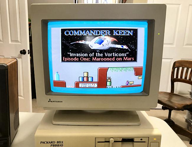 A Packard-Bell PC with a CRT monitor running Commander Keen.