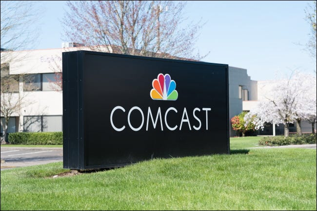 A Comcast sign outside of a commercial building.